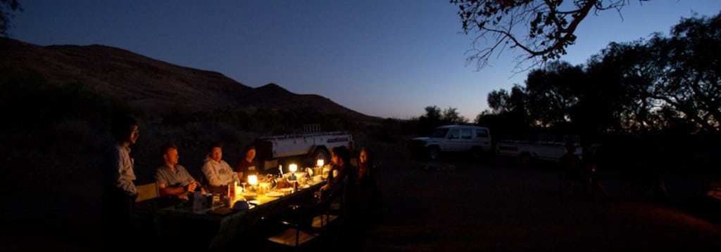 Dinner under the stars in Namibia, mountain biking safari tour