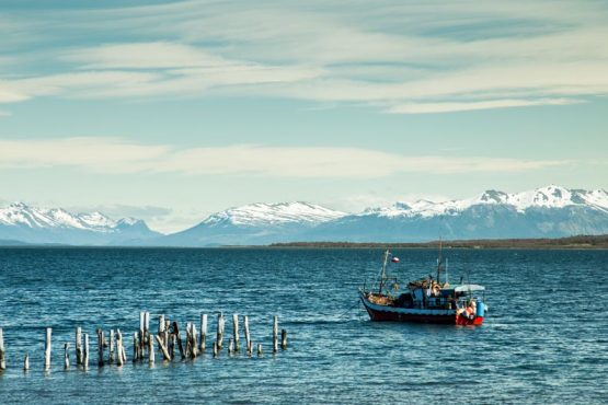 Boat on the ocean at Puerto Natales, Patagonia on our mountain bike tour Chile