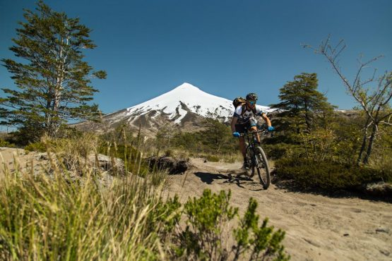 Mountain biking in the shadow of Puyehue volcano in Chile on our mountain bike tour Chile