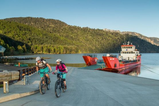 Biking off the ferry at Puerto Fuy, Chile on our mountain bike tour Chile