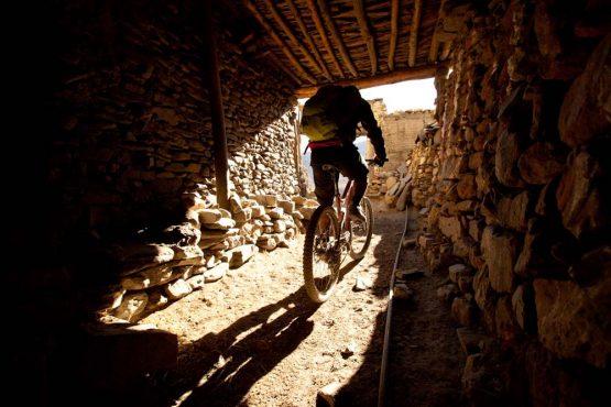 Mountain biking through ancient villages ion our mountain bike tour Nepal