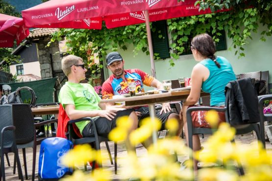 Enjoying a 'Cockta' stop on our mountain bike tour Slovenia