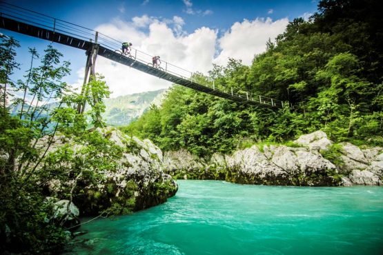 Biking over the Soca River on our mountain bike tour Slovenia