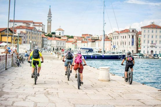 Mountain biking at Piran harbour on our mountain bike tour Slovenia