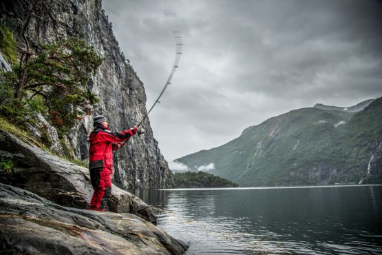Sven, fishing for dinner. You'll enjoy the freshest local ingredients during your time on HMS Gåssten on our Fjords of Norway mountain bike tour