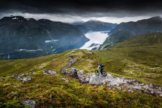 Rock rolling into a technical singletrack descent on our Fjords of Norway mountain bike tour