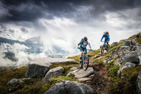 Testing, technical rock riding along steep mountainsides in Norway on our Fjords of Norway mountain bike tour