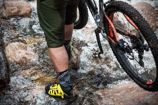 Carefully crossing Highland streams on the Cairngorms mountain bike tour