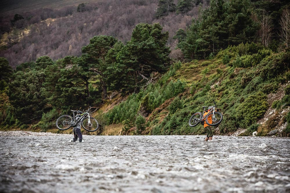 Taking on river crossings as part of the Cairngorms mountain bike tour