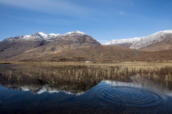 Snow-capped mountains in Torridon, coast-to-coast Scotland mountain bike tour