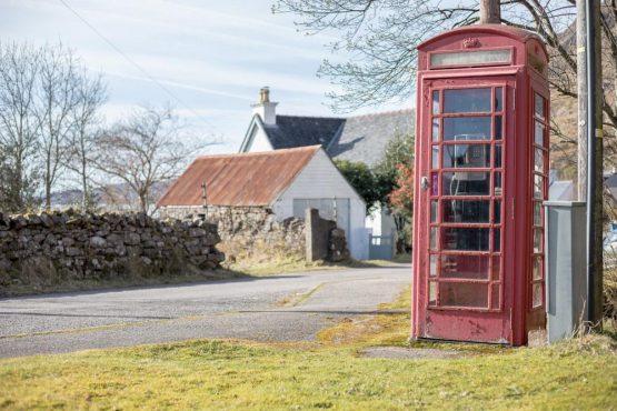 Telephone box in Torridon village, coast-to-coast Scotland mountain bike tour
