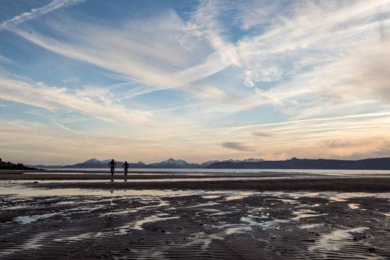 Riding on the beach at the end of the coast-to-coast Scotland mountain bike tour