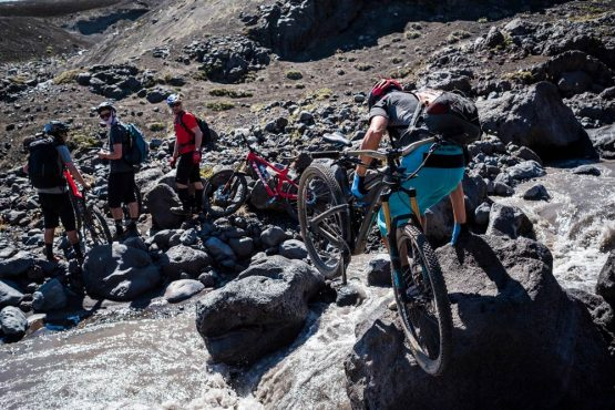 Crossing glacial stream on our mountain bike tour Chile