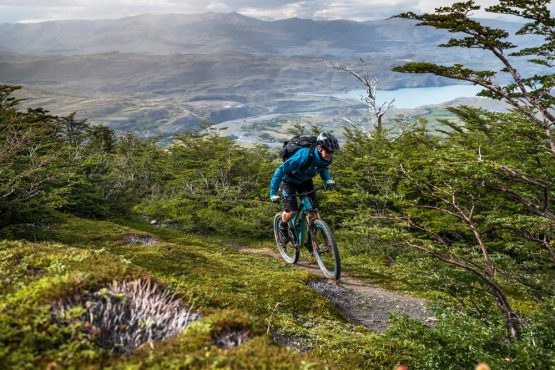 Mountain biker climbs in Patagonia, mountain bike tour Chile