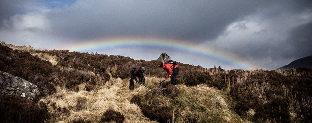 Working under moody skies and a rainbow on the Tea-Hut Path in Torridon at the Take Care of Your Trails in Torridon.