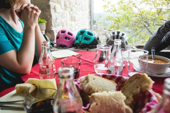 Lunch table and bike helmets, mountain bike tour Croatia