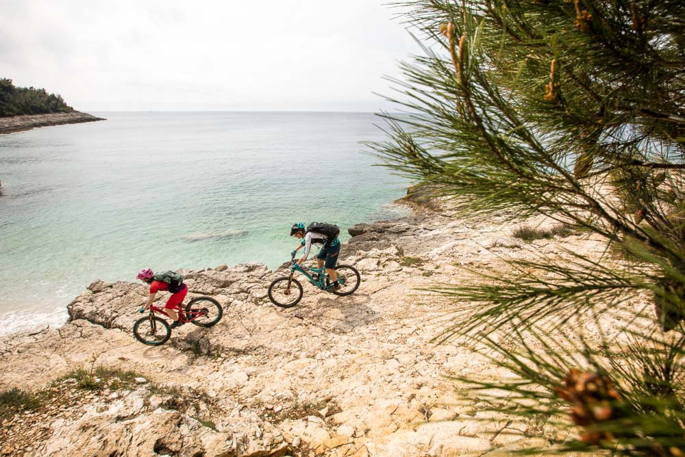 Mountain bikers on the beach, mountain bike tour Croatia