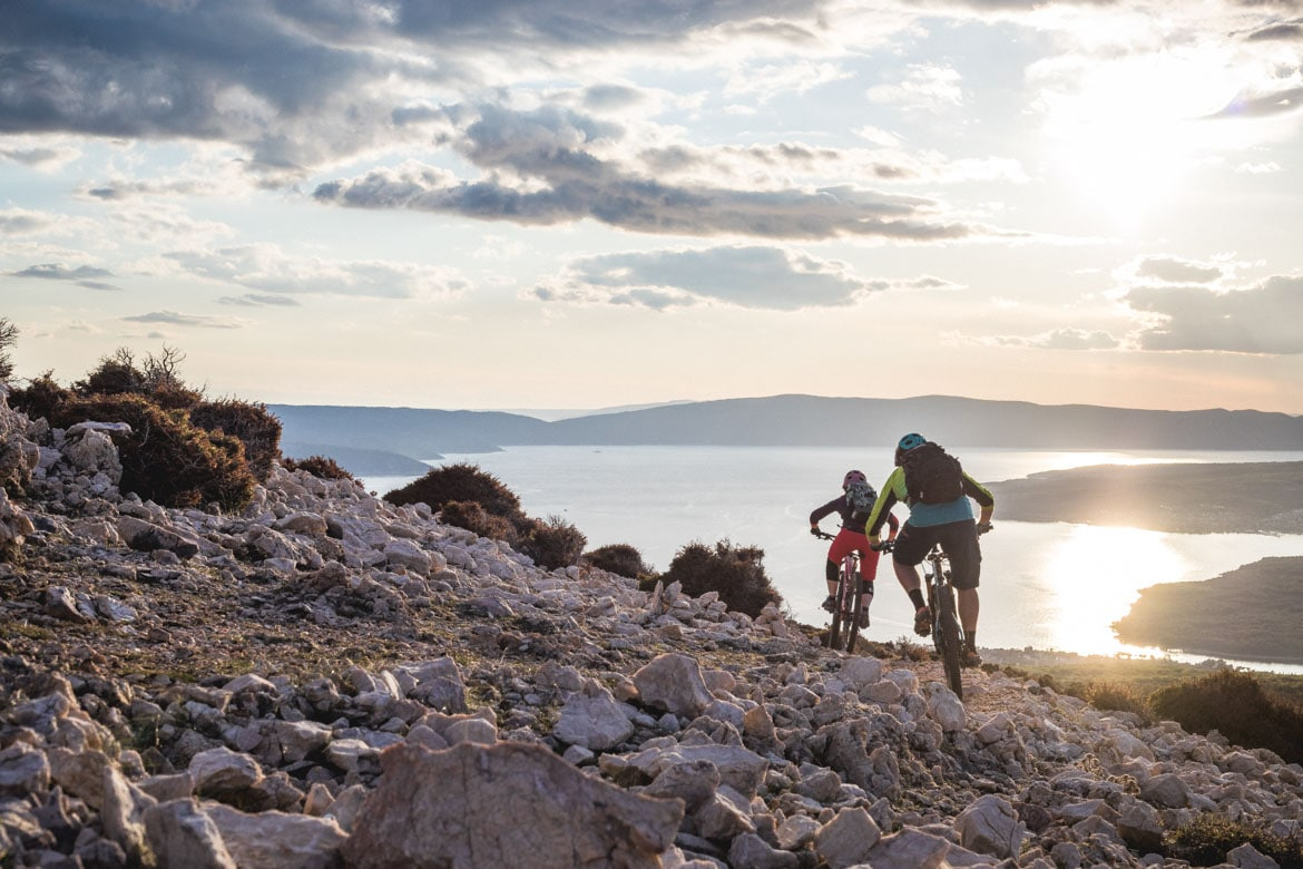 Descending into the sunset in our Croatia Mountain Bike Tour.