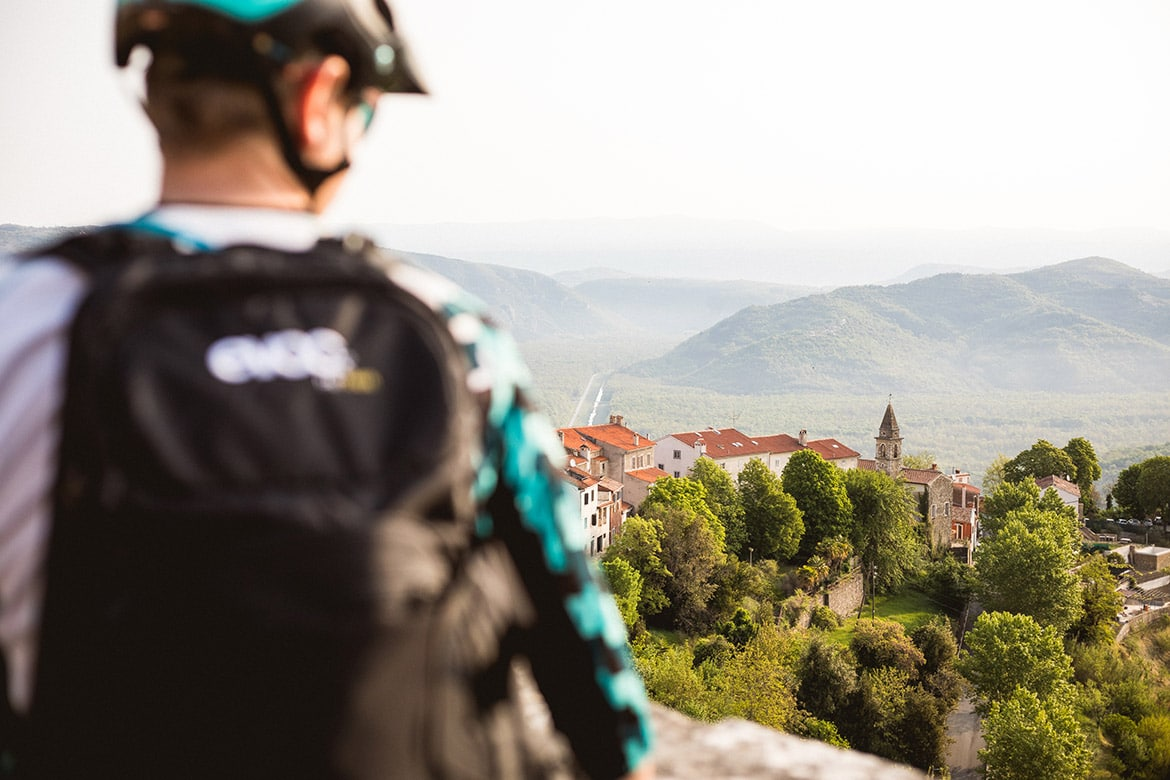 Cyclist looking out from Groznjan, part of our 5 Tips For Your First Mountain Bike Tour.