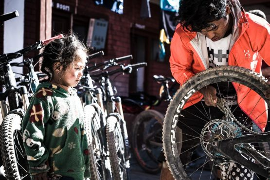 Mountain bike tour Nepal - RJ on mechanic duty