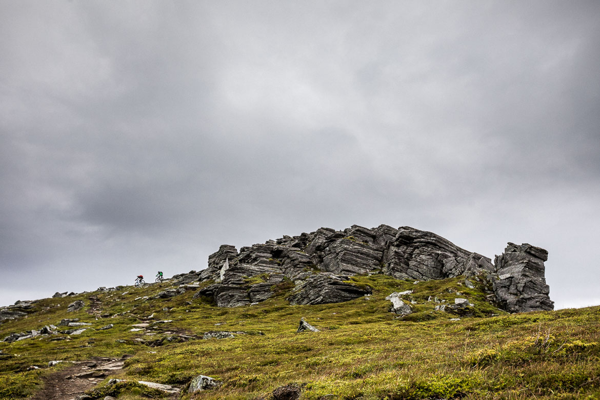 Two mountain bikers descending on the west coast of Norway, part of our mountain bike tour Norway.