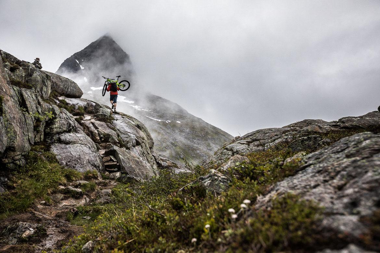 Hike-a-bike in Trollstigen during our mountain bike tour Norway.