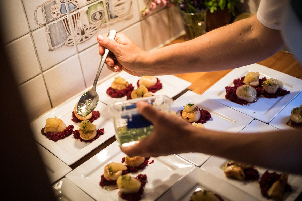 Scallops being prepared by the chef onboard Gaasten during our mountainbike tour Norway.