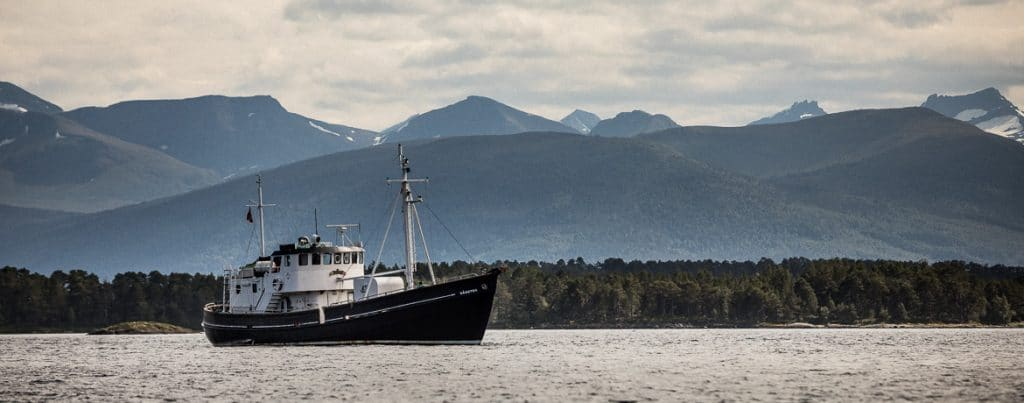 Gaasten moored in the sea outside Molde during our mountainbike tour Norway.