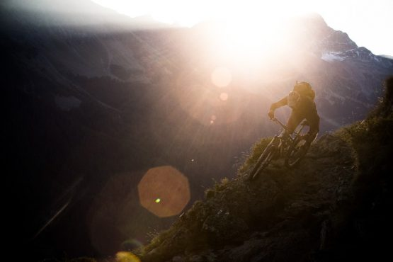 Thomas Vanderham rails a high alpine trail near Italy, on our mountain bike tour Switzerland