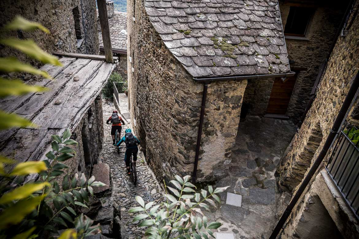 Descending through narrow alleyways towards Tirano during our mountain bike tour Switzerland.