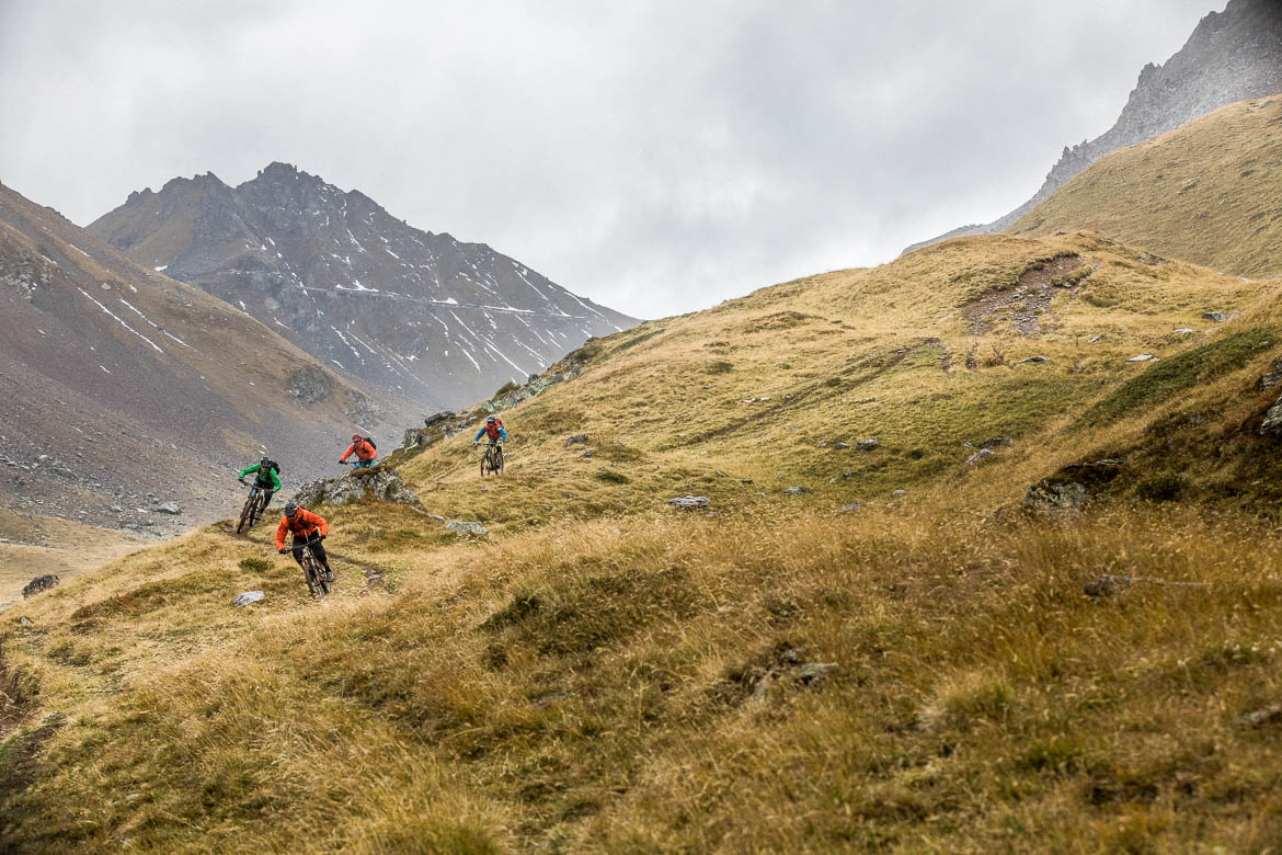 A group of mountain bikers descending towards Arosa from Lenzerheide, part of our mountain bike tour Switzerland.