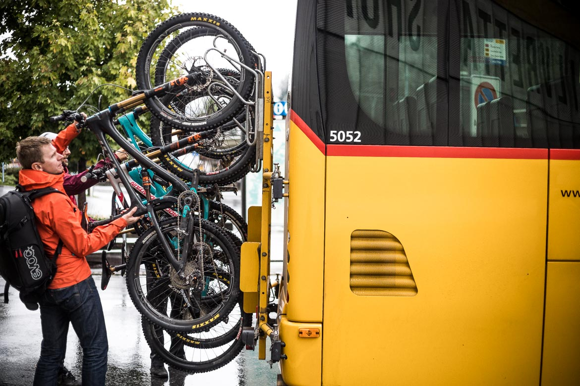 Taking bikes off the PostBus in Davos during our mountain bike tour Switzerland.