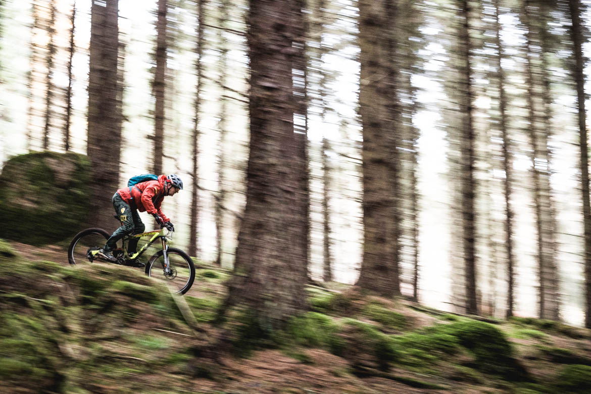 Trials legend Hans Rey descending a trail on the Mast hill in Inverness, Scotland.