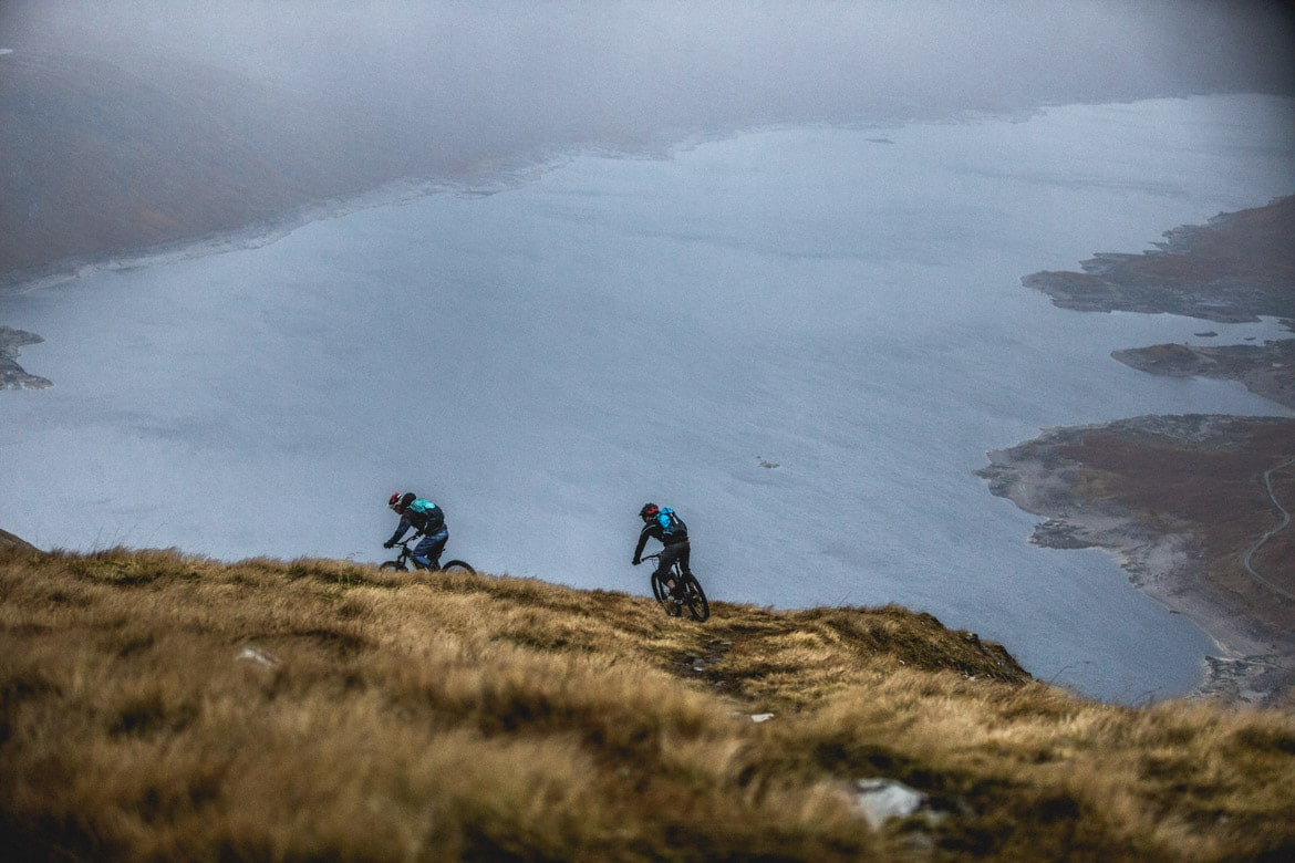 Joe Barnes following Max Schumann above Loch Quoich.
