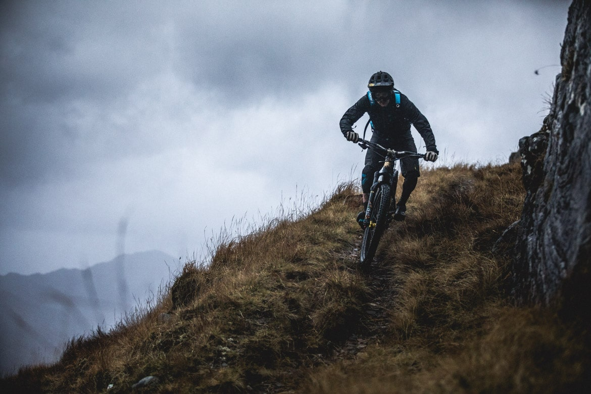 Joe Barnes rides his Canyon Spectral down a Scottish mountain.