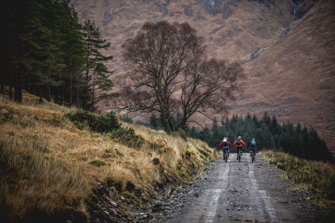 Joe Barnes, Max Schumann, and Euan Wilson of H+I Adventures heading into the hills of Scotland.