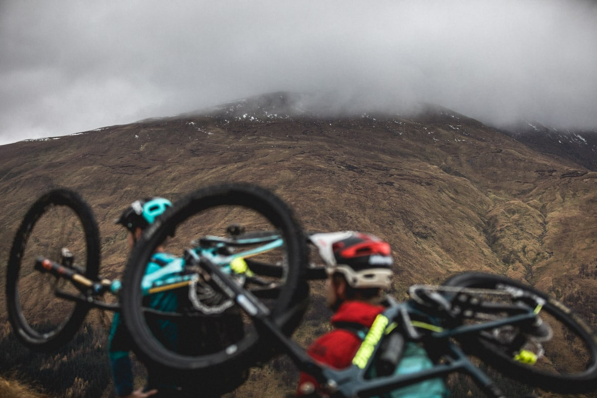 Joe Barnes, Max Schumann, and Euan Wilson begin the ascent up Gleouraich. Hike a biking is part of our mountain biking tips blog.