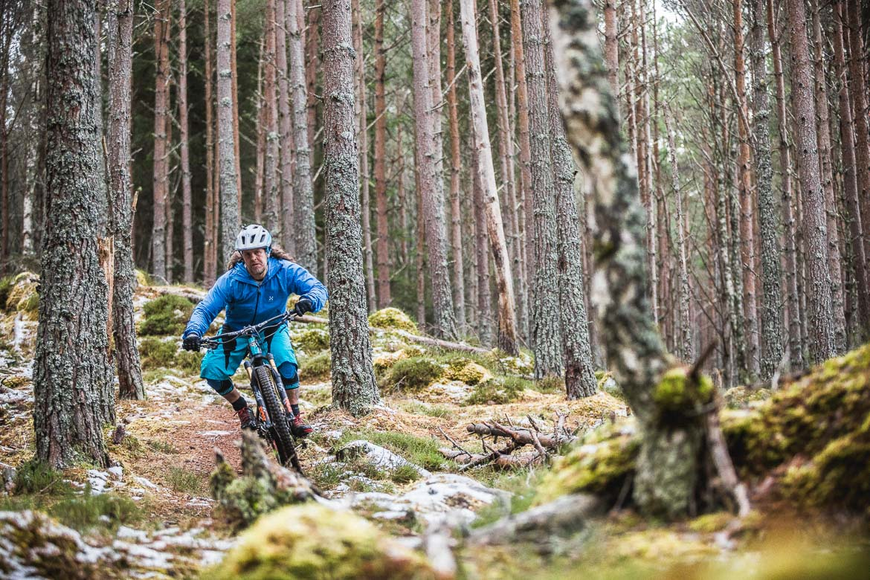 Jono Baldwin mountain biking through the forest