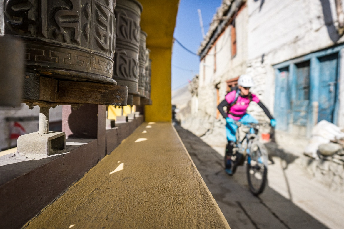 Mustang Valley, Nepal - prayer wheels and riding