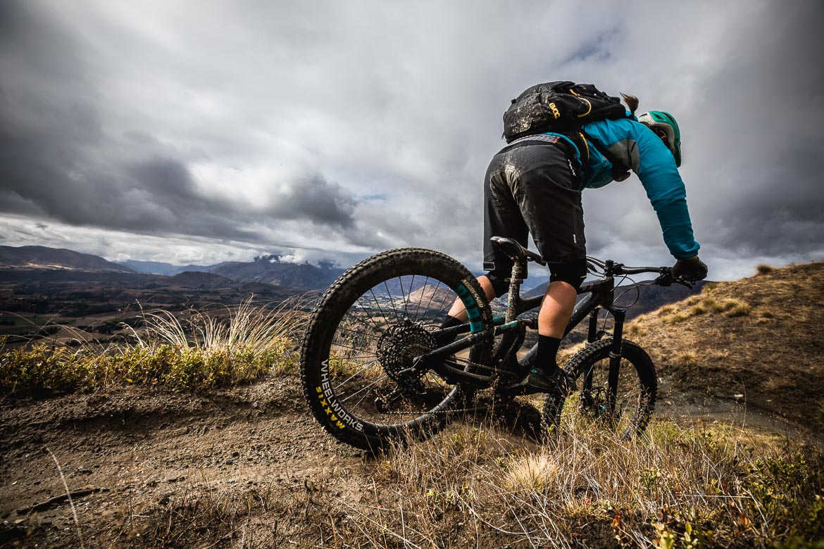Mountain biker descending the Zoots trail on Coronet Peak in Queenstown.