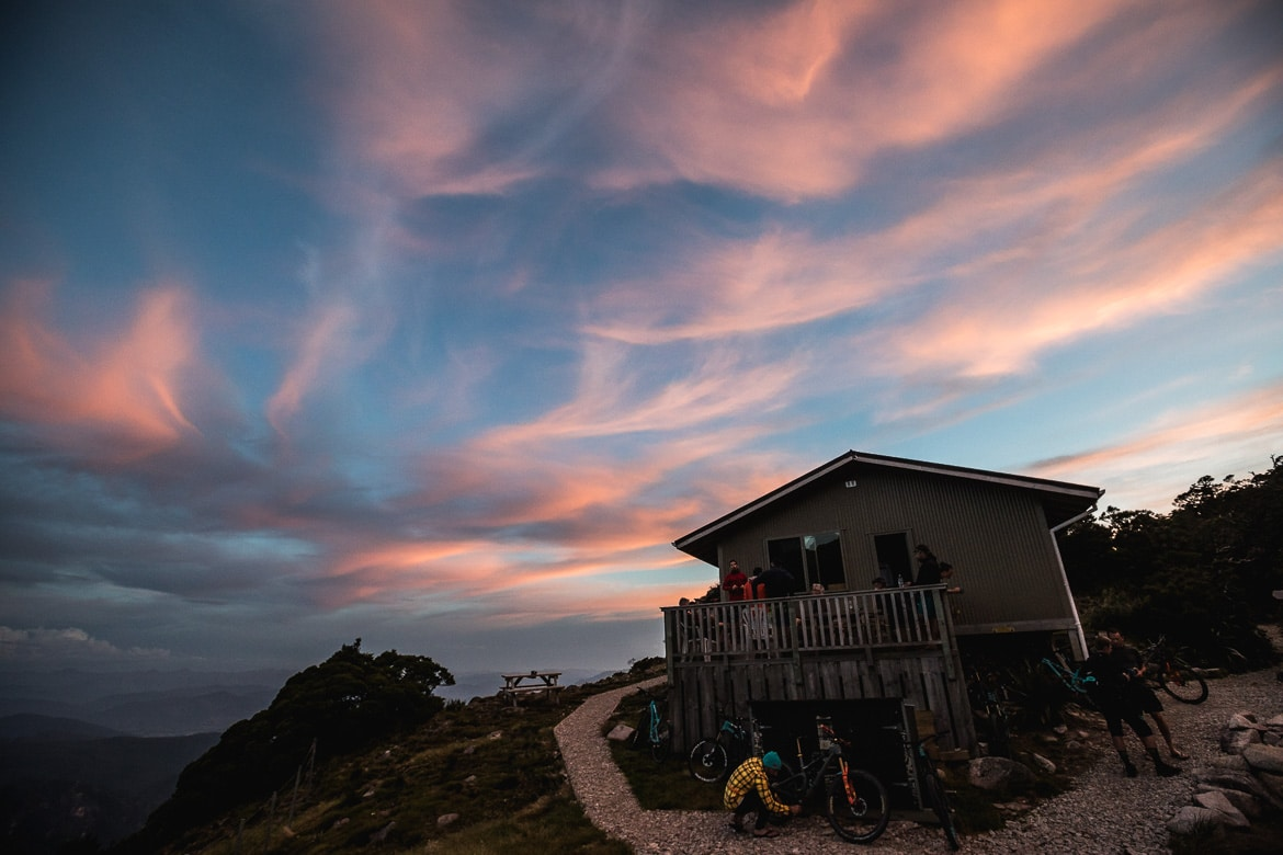 Amazing sunset over the Ghost Lake Hut after riding the Old Ghost Road during the International Yeti Tribe New Zealand mountain bike tour.