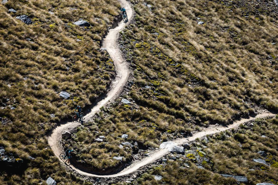 Riding the rollercoaster of trails at Cardrona Bike Park near Queenstown during the International Yeti Tribe New Zealand mountain bike tour.