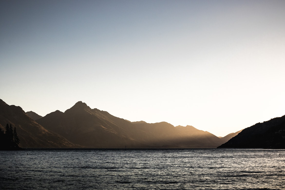 Sunset over the lake in Queenstown during the International Yeti Tribe New Zealand mountain bike tour.