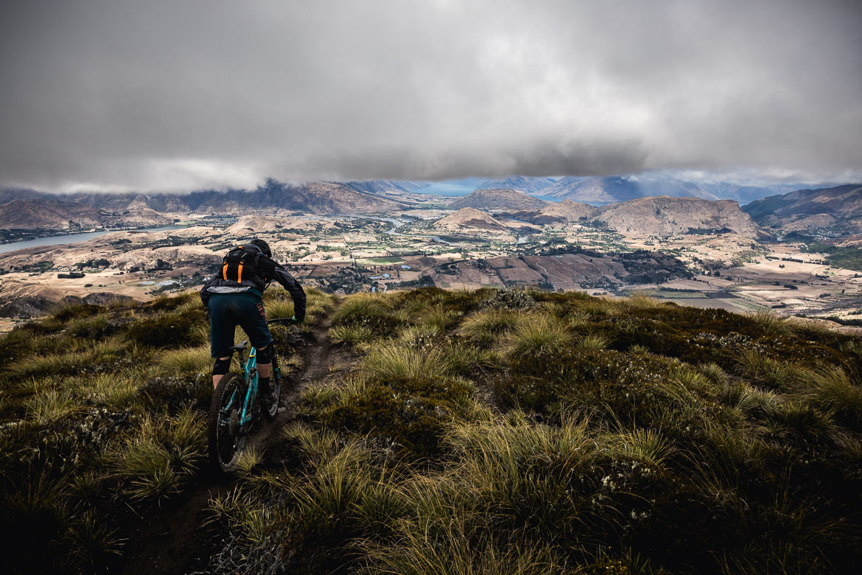 Mountain biker riding Coronet Peak near Queenstown during the International Yeti Tribe New Zealand mountain bike tour.
