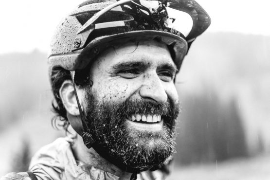 Black and white portrait of muddy mountain biker during our mountain bike tour Colorado.