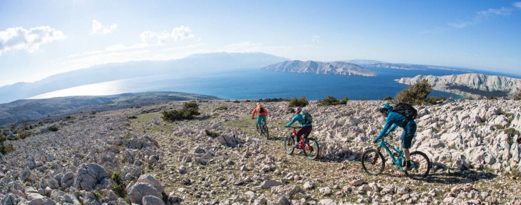 Mountain bikers riding Krk Island during out mountain bike tour Croatia. Exploring the Croatian mtb scene
