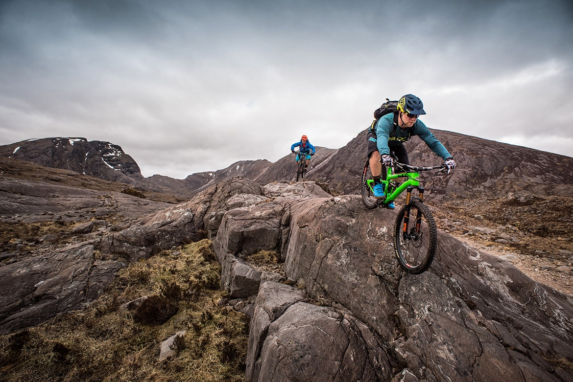 Top 10 mountain bike trails - Mountain bikers riding in Achnaschellach during a Scotland coast to coast mountain bike tour. One of our mountain biking adventures in Europe.