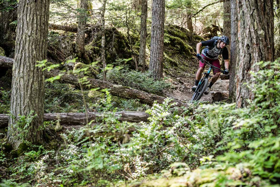 Mountain bike guide Ali turns quickly through our MTB trails in British Columbia