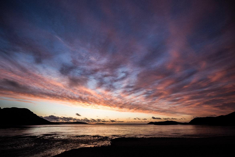 Bikerafting Scotland, purple skies over the sea