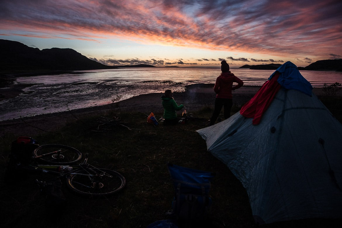 Red skies at the campsite, bikerafting Scotland